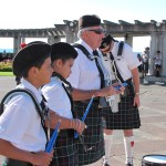 Our drummers wait while the pipers tune